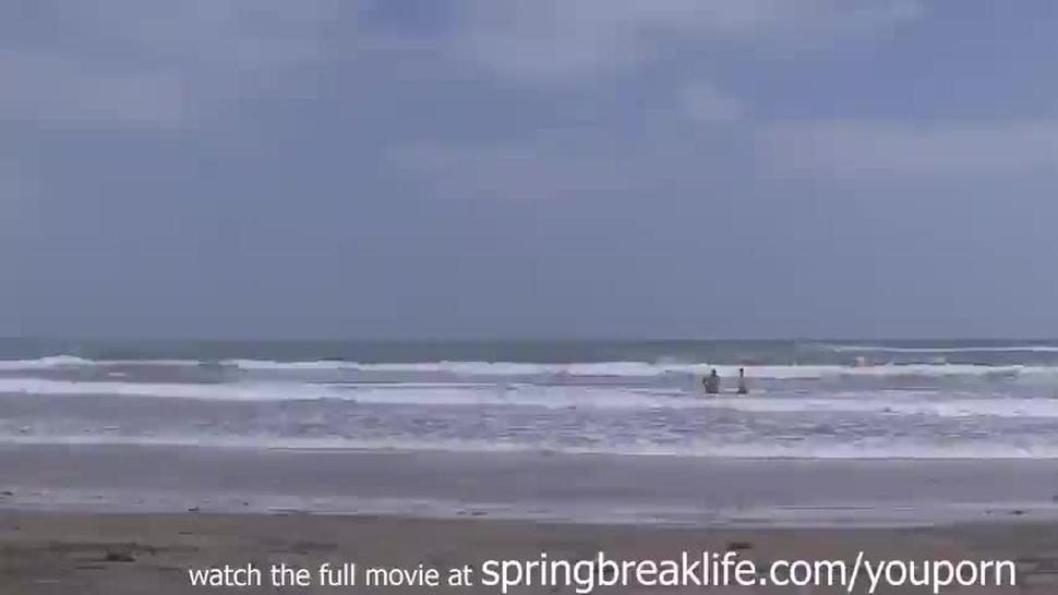 cute coeds flashing at the beach