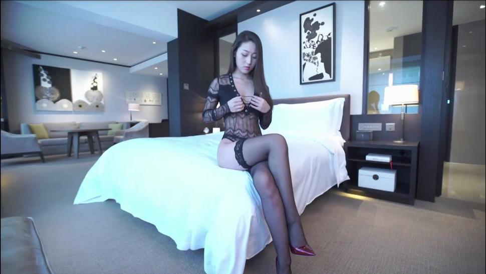 Model Liu Xran kneels down to feed the photographer