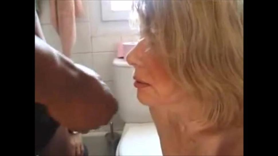 Hot granny is taking a bbc cum in mouth then pissing on it