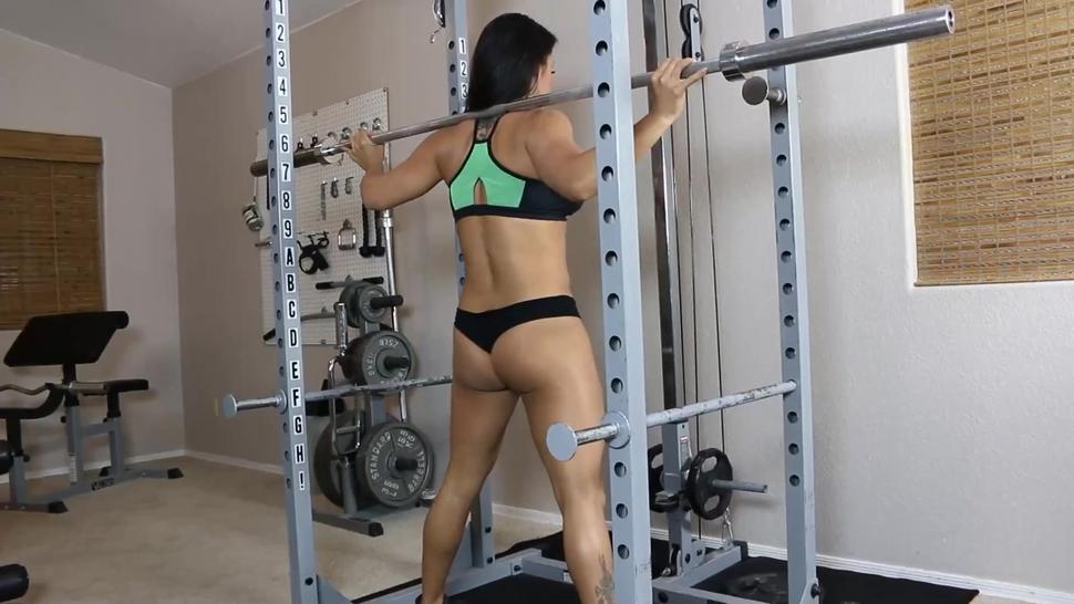 Two Latinas doing sexy squats in the gym