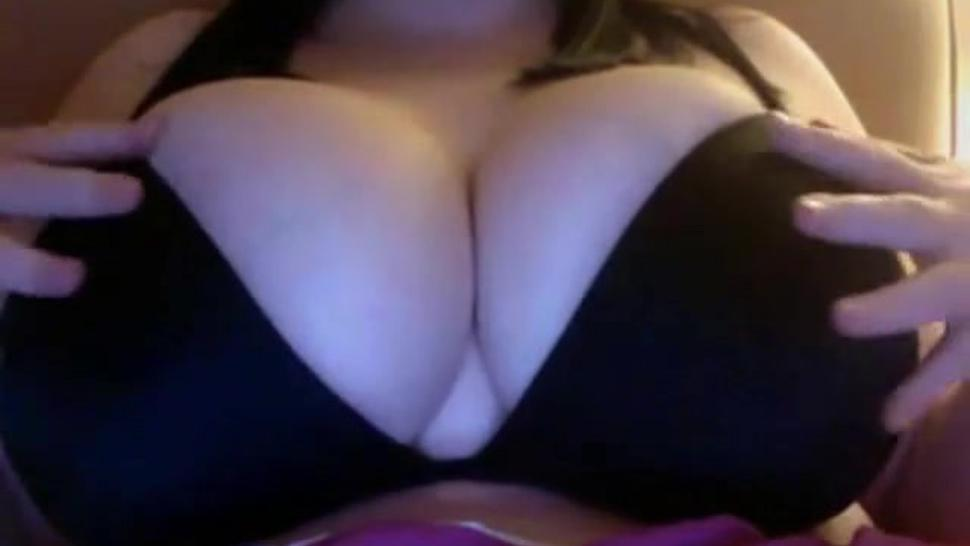 Big-eyed chubby beauty shows off her amazing tits