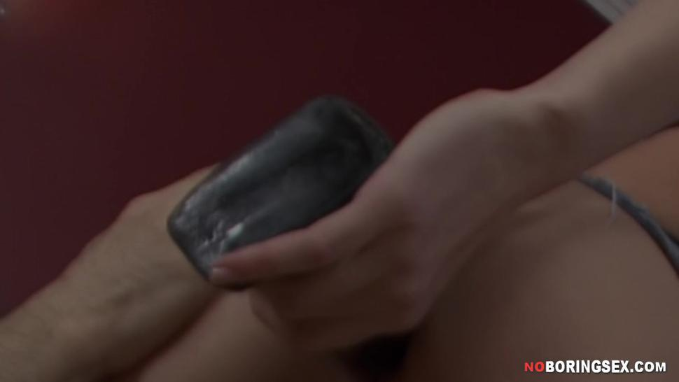 Sexy brunette prepares her ass with a huge dildo