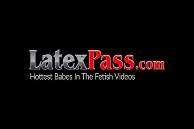 LATEX PUSSY CATS - Latex mistress puts lesbian sub onto the dildo machine