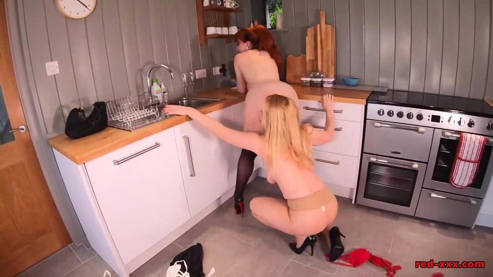 Red XXX and her naughty girlfriend screw in the kitchen