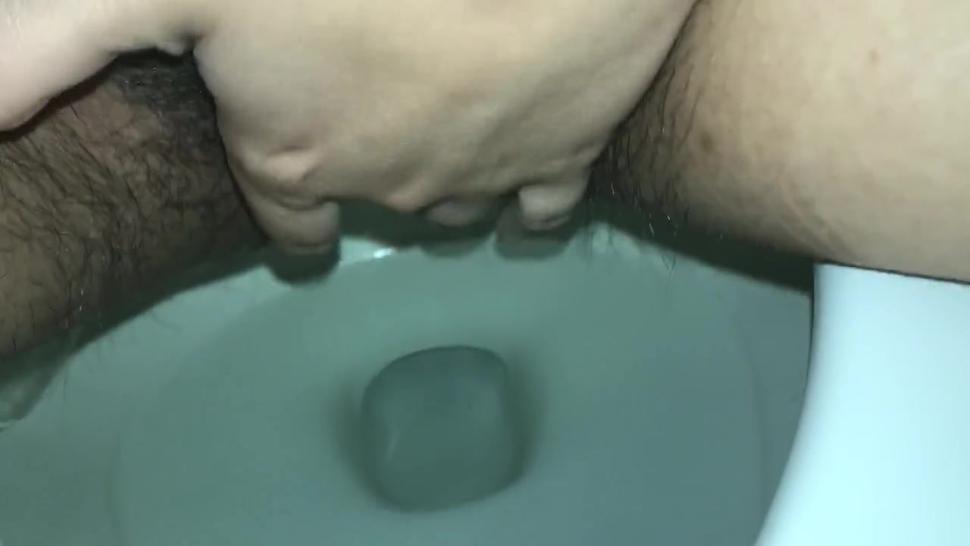 Girl Pees in Toilet