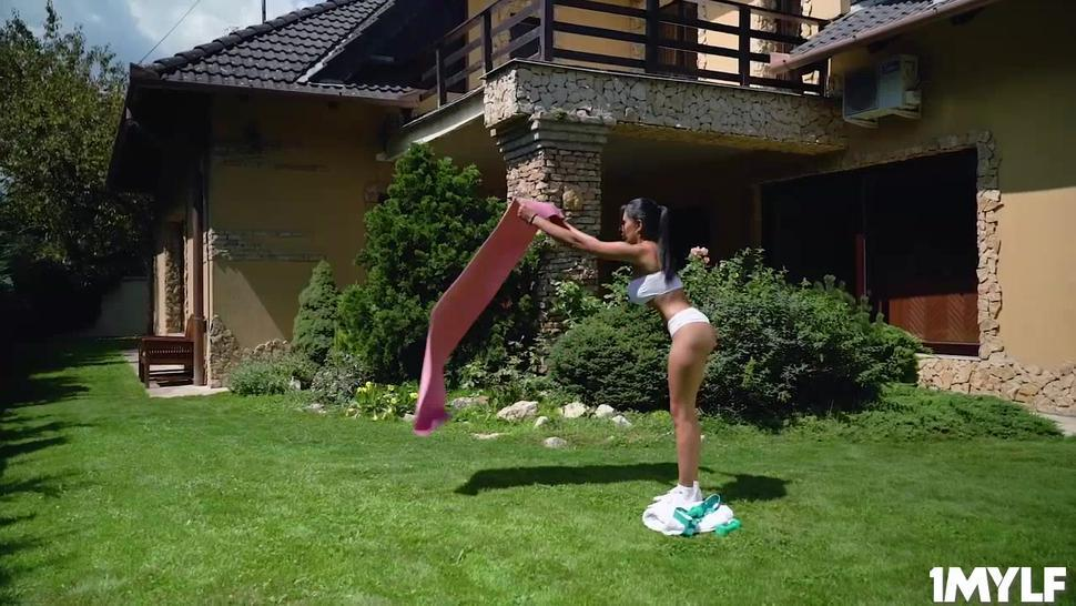 Trainer helps Katrina Moreno with her sexy out door training