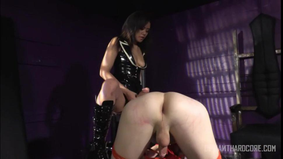 women in latex fucked a man with strapon