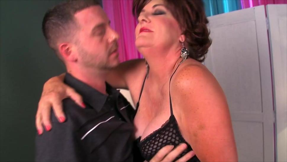 Mature brunette wears sexy lingerie for this stud