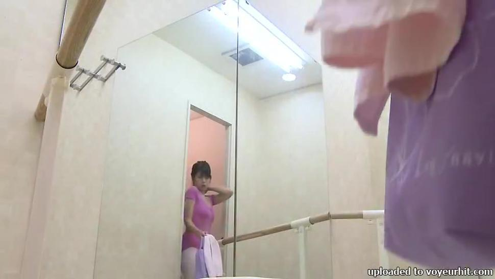 A fresh Japanese ballet dancer is taking off her training suit and putting on her casual wear