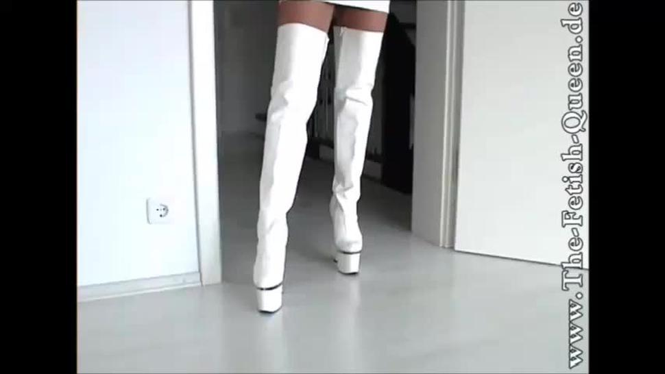 Fetish-Queen - White high boots and plastic raincoat