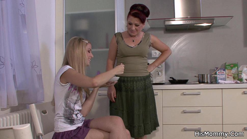 HIS MOMMY - Mom and teen lesbian have fun on the kitchen