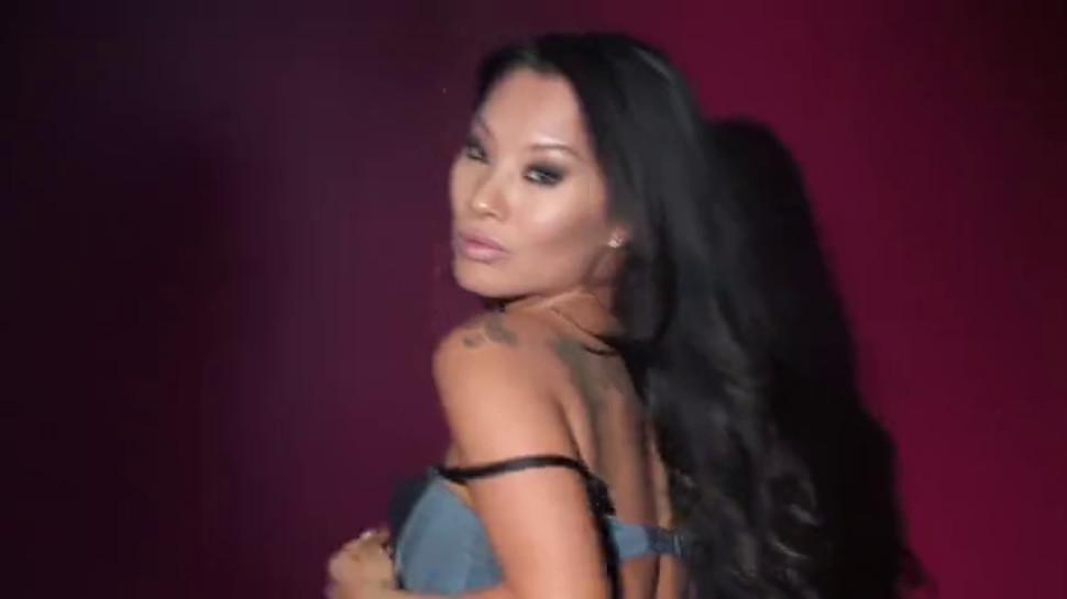 Sexy Leya Falcon strips at a gold covered strip club