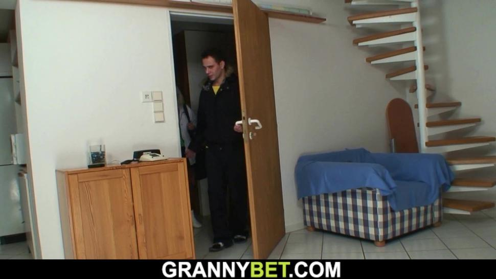 GRANNYBET - Old blonde granny in stocking spreads legs for him