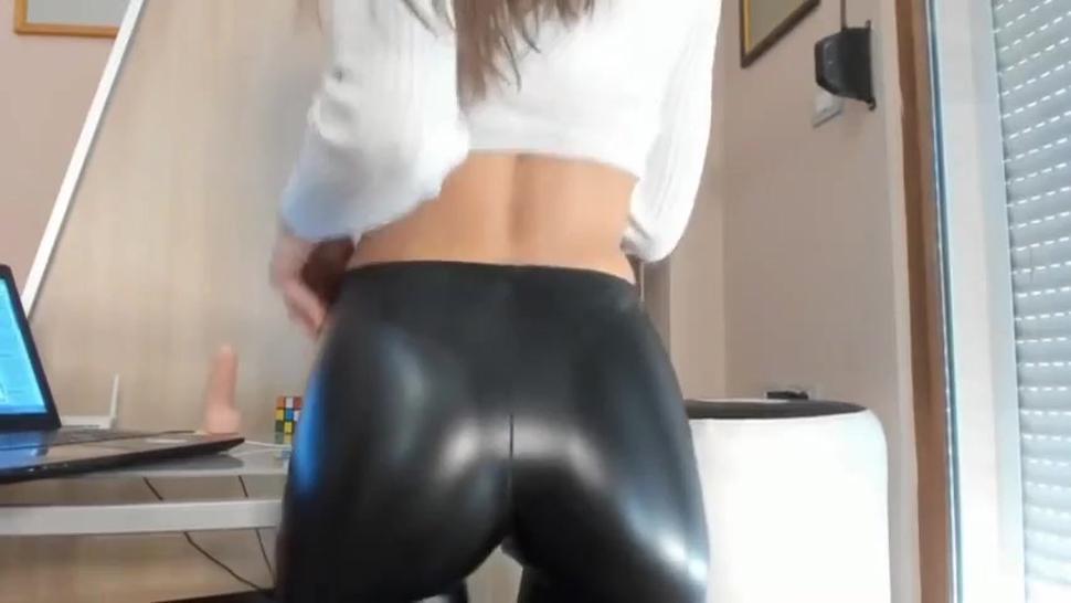Hot cam model in shiny spandex