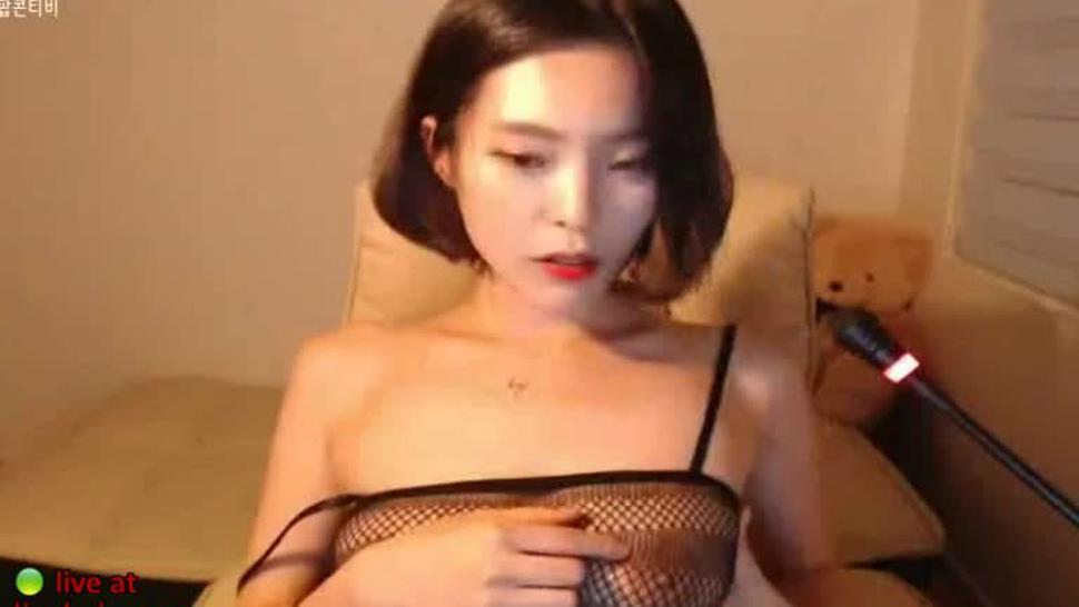 Sensual Korean babe shows her big boobs