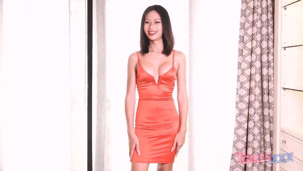 Bangkok Ladyboy In Orange Dress Priya Has A Beautiful Big Dick