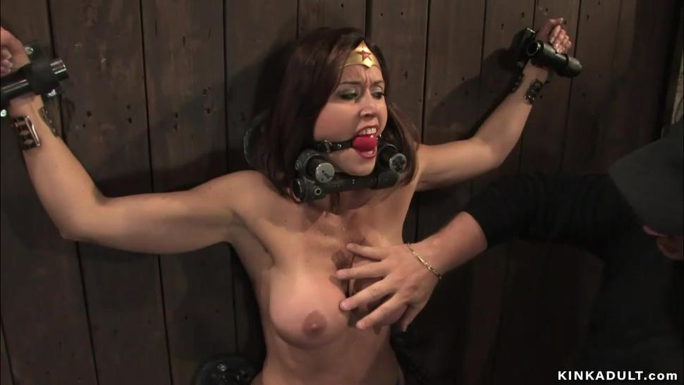 Busty Wunder Woman bound to the wall