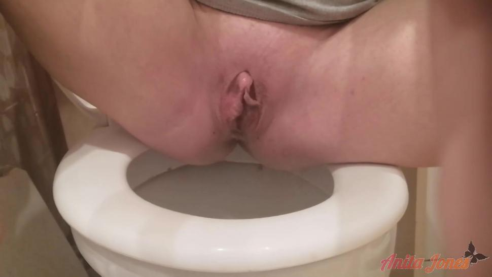 Pissing loudly in a public restroom
