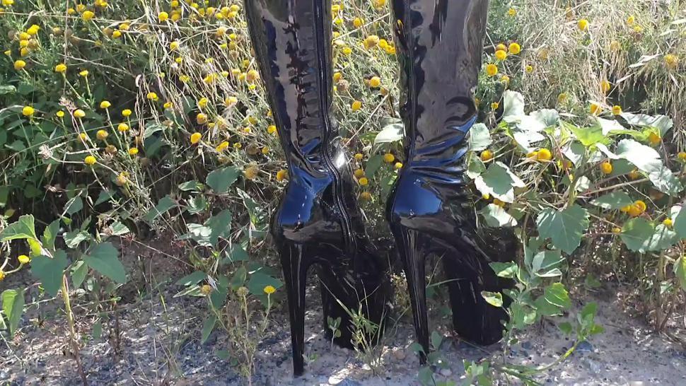 Walking in garden in strip boots. Hot mommy fetish