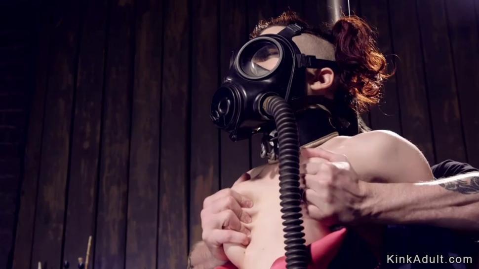 Masked redhead slave in device bondage