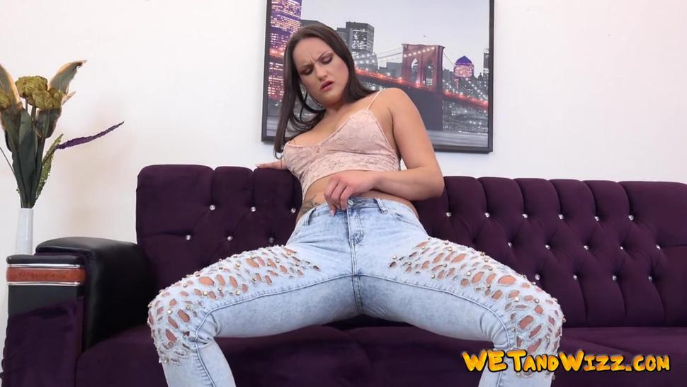 Naughty babe pissing in her denim jeans solo