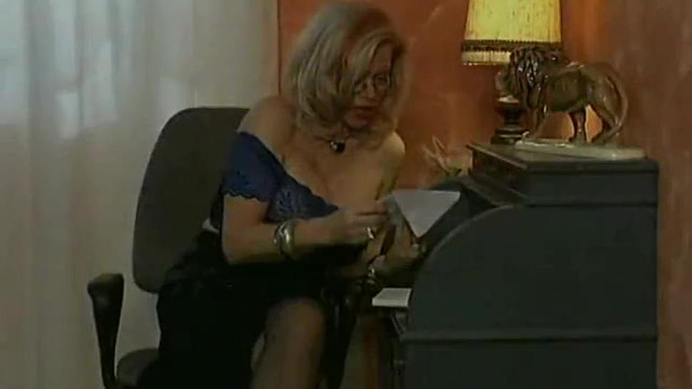 Blonde mature Babette Blue takes it in stockings and heels