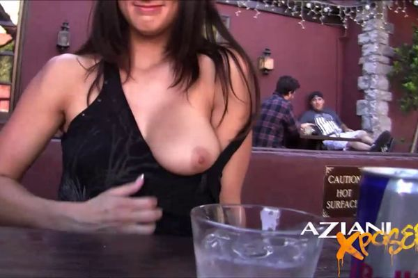Sexy Brunette Loves Showing Off Her Pussy In Public At Bar In