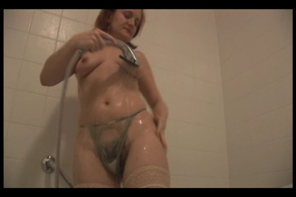 Milf in shower showing off hairy pussy