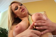 Young busty Lilian toy her slick twat