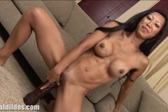 Tight bodied brunette fills her pussy with a huge dildo