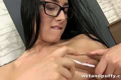 Sexy babe with glasses teasing her smooth clit