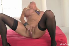 Nikita Von James fucks herself to a climax