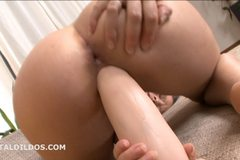 Brunette teen riding a brutal dildo until she cums