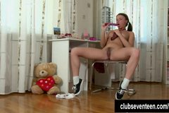 Pigtailed schoolgirl toy pussy upskirt