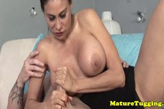 Glam milf tugging a cock with her bigtits out