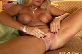 Sexy cougar slips out of her panties