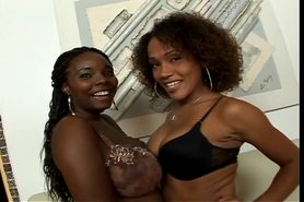Kinky black lesbians play with a dildo on the couch