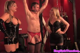 Mistresses humiliate bound sissy by whipping