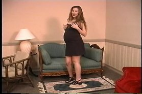 Hot pregnant brunette masturbates on a couch