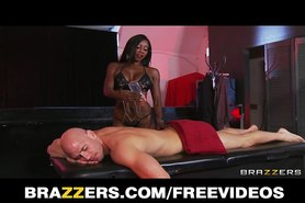 Curvy Ebony masseuse oils herself up for some deep anal