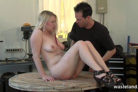 Blonde slave is tied down on the table and flogged