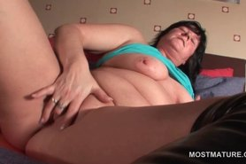 Brunette mature rubs pussy and teased boobs