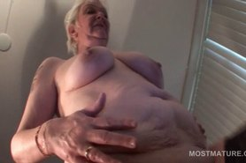 Kinky stockinged mature rubbing her starved soft cunt