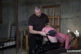 Blonde girl in fishnet dress gets spanked and flogged by her Master
