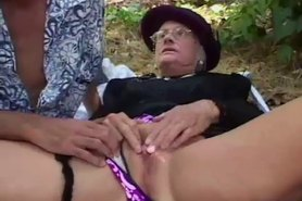 Granny fucks outdoor