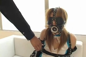 Tongue teasing for blindfolded masked Oriental girl