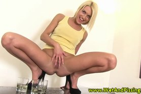 Blonde fills her glasses with golden shower before sipping