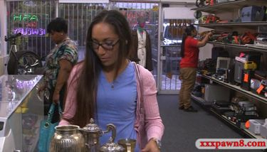 Desperate nurse selling her old teapot in the pawnshop